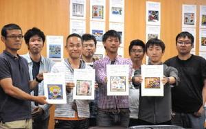 応募作品の中から選んだ優秀作品を手にする県農協青年部協議会のメンバーら=佐賀市のJA会館