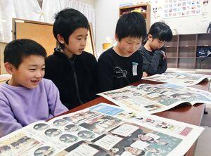 子ども佐賀新聞を読む児童=武雄市朝日町の放課後児童クラブ
