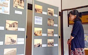 時代背景を説明するパネルとともに展示された古写真=佐賀市柳町の旧古賀家