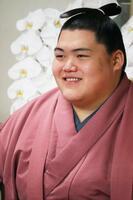 新十両に昇進し、オンラインで記者会見した王鵬=25日午前、東京都江東区の大嶽部屋(日本相撲協会提供)
