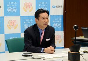 「まん延防止等重点措置」について考えを述べた山口祥義知事=県庁