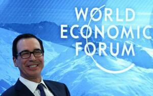 22日、世界経済フォーラム年次総会(ダボス会議)の討論会に出席したムニューシン米財務長官=スイス・ダボス(ロイター=共同)