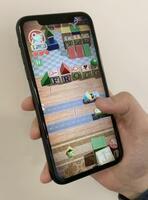 定額制ゲーム配信サービス「アップルアーケード」のゲーム=19日、ニューヨーク(共同)