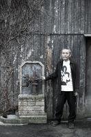 唐津の歴史を拾遺する筆者の田中誠さん=唐津市米屋町通り