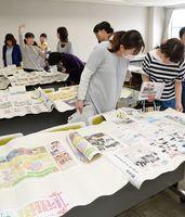 PTA広報紙の制作に関して、過去の紙面を見て参考にする関係者たち=佐賀市のアバンセ