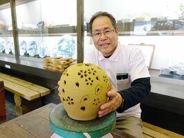 「人の心を豊かにできる館にしたい」と話す山田龍介館長