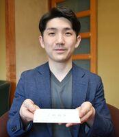 前売り券について「これから先の楽しみになれば」と話す北川健太社長=嬉野市の旅館「大村屋」