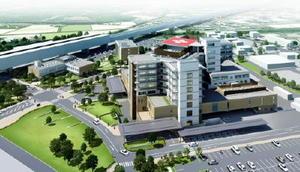 九州新幹線長崎ルートの嬉野温泉駅(仮称・画面左上)の西側に移転新築される国立病院機構嬉野医療センターの完成予想図(提供)