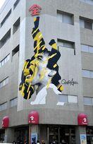 佐賀玉屋に古賀稔彦さんの巨大壁画が登場 5月末まで