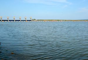 国営諫早湾干拓の調整池。奥は潮受け堤防排水門=8月、長崎県諫早市