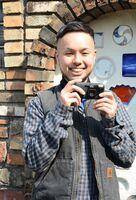 有田の日常を写真に収めている壱岐成太郎さん=有田町役場