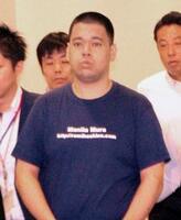 成田空港に到着した星野路実容疑者=24日午後