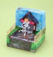 「すてきなデザイン・アイデア賞」に選ばれた武富さんの作品。お金を入れると干したイカが回り始める