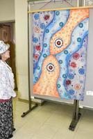 田中丸亮子さんの染織工芸品「宙 銀河の融合 人類に希む」など会員の力作54点を展示=多久市の中央公民館