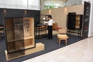 23日まで展示される諸富家具ブランド「ARIAKE 有明」=佐賀市松原の佐賀バルーンミュージアム