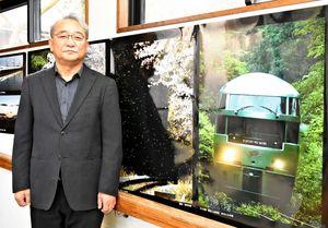 「10日間かけて撮影することもある」と話す新原和俊さん=佐賀市富士町の熊の川温泉「ちどりの湯」