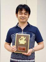 第72回全日本アマチュア将棋名人戦県大会で初優勝した山口宗一郎4段=佐賀市の佐賀新聞社