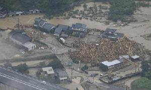 記録的な大雨で浸水した福岡県朝倉市内=6日午前10時26分(共同通信社ヘリから)