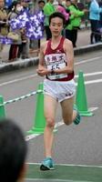 ハーフマラソン一般男子に初出場し6位入賞した井手孝一(鳥栖工高)=鹿島市の林業体育館前