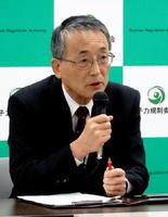 玄海原発3、4号機の審査について記者会見する田中俊一委員長=東京・六本木の原子力規制委員会